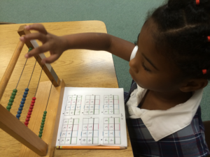 a girl playing abacus